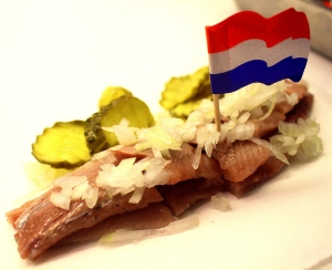 Lightly brined herring, sold at stands throughout Amsterdam, is a popular Dutch snack.